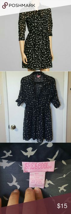 She's Cool Birds Dress Navy and taupe Birds button down sheer dress with a 3/4 roll up sleeve and elastic wasteband size Large. There is a small snag on the back of the dress.  Nit very visible since it blends in but is shown in pic# 6. she's cool Dresses