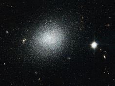 'Like Salt Sprinkled on Black Velvet'.  The NASA/ESA Hubble Space Telescope has captured this view of the dwarf galaxy UGC 5497, which looks a bit like salt sprinkled on black velvet in this image.  The object is a compact blue dwarf galaxy that is infused with newly formed clusters of stars. The bright, blue stars that arise in these clusters help to give the galaxy an overall bluish appearance that lasts for several million years until these fast-burning stars explode as supernovae.