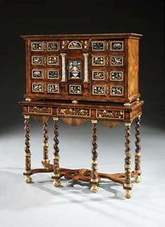 - A CHARLES II COCUS WOOD AND PIETRA DURA CABINET ON STAND