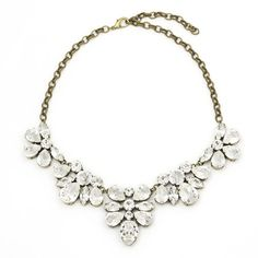 This statement bib style necklace made with Swarovski clear crystal stones, is the ultimate in luxe accessories. Perfect for dressing up any outfit - from a black cocktail dress for the perfect date n. Swarovski Stones, Stones And Crystals, Crystal Statement Necklace, Races Fashion, Perfect Date, Bridal Necklace, Clear Crystal, Jewelry Collection, Bling