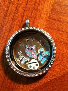 Origami Owl...custom lockets, designed by you, to tell your story!