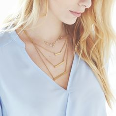 This season's must-have accessory? Dainty metallic chains. Get layering.