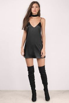 black thigh high boots on bare legs with a short dress | #thighhighboots