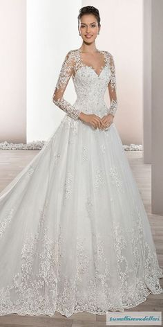 Delicately beaded appliques embellish this romantic Tulle Ball gown with Sweetheart neckline and elegant sheer sleeves with lace accents that flow into a dramatic, low sheer back with button closure. The back features a stunning lace embellished Cathedral Dream Wedding Dresses, Bridal Dresses, Wedding Gowns, Lace Wedding, Bridesmaid Dresses, 2017 Wedding, Trendy Wedding, Wedding Shoes, 2017 Bridal