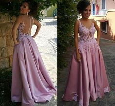 Be the queen in this gorgeous pink gown at your prom . Featuring the illusion neckline with delicate lace applique detail ,A line skirt and sheer back . $167