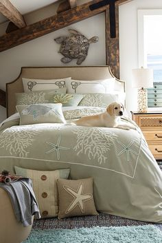You and your fur baby can drift off to sleep in a smoke blue sea adorned with shells, coral and starfish. Pier 1's Elegant Coastal Duvet Cover and Shams set the tone for the peaceful calm that lapping waves and gentle colors elicit. Add the coordinating Euro sham and oblong pillow to create a bed that's welcoming, uncomplicated and restful.