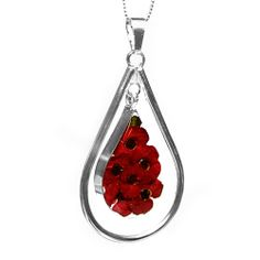 Sterling Silver and Real Poppy Flowers, Teardrop Shaped Pendant Stunning real bright red poppies are hand set in this sterling silver teardrop shaped swinging pendant. Poppies are thought of as a symbol of love and togetherness. The sterling silver chain is 18 inches. The flowers have been expertly cultivated by master gardeners, briefly dried & then set in resin & sterling silver to be cherished for years to come.  £60.00
