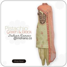 Elegant pistachio green and black salwar kameez featuring in dull gold ornate hand embroidery