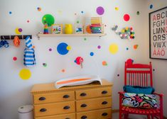 These primary color wall decals give this nursery a whimsical feel!