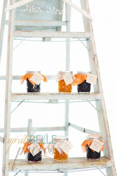 rustic ladder displaying jarred bridal shower favors| http://mytrueblu.com/a-surprise-bridal-shower-for-faith/