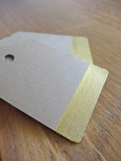 Every Christmas gift needs a handmade gift tag!  These tags are punched from brown kraft paper and painted with a gold acrylic stripe. Reverse side is blank.