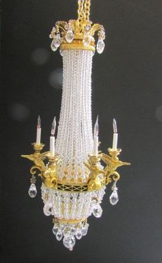 Swarovski is 'the' name in crystals and this beautiful chandelier sings quality with its numerous crystals. Measuring approx 135mm in length each crystal has been hand picked and individually positioned on the brass wire supports. The other brass detailing has also been hand carved and cast to make this a unique piece. It is wired for electric and when lit up the crystals 'sparkle'.