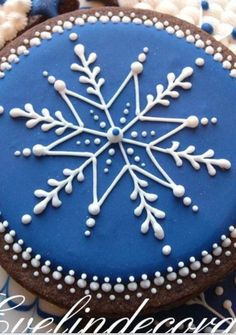 Deep dark blue and snowflake winter biscuits. Perfect as a gift.