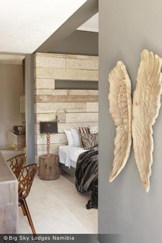 Think this might be stone/tile of some kind as a headboard, but would be cool to use white-washed reclaimed wood. I like that it's built out from the wall a few inches to give it depth.