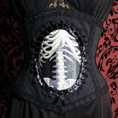 Google Image Result for http://calamitykim.typepad.com/photos/uncategorized/2007/07/16/med_skeleton_corset.jpg