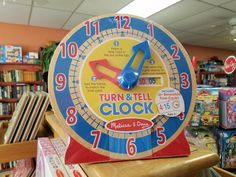 The Turn & Tell Clock from Melissa & Doug is an educational toy that helps children learn how time works, and how to count the hours and minutes. The clock has a sturdy wooden base to keep it standing still. It comes with over 12+ reversible time cards which can be inserted into a slot on the top to help children keep track of the time their trying to change the clock to. Melissa & Doug, Book Gifts, Educational Toys, Kids Learning, Slot, Count, Track, Things To Come, Base