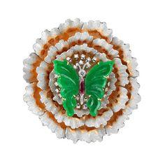 Buccellati, Broche en or, diamants, rubis et jade gravé.