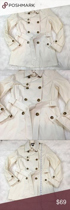 Tommy Hilfiger American Classics Ivory Trench Coat Women's Tommy Hilfiger Belted Ivory American Classics Trench Coat Size M.  Shell: 57% Cotton, 43% Polyester.  Lining: 100% Polyester.  Please see pictures for measurements.  Smoke free home. Tommy Hilfiger Jackets & Coats Trench Coats