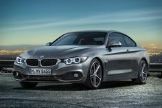 """2014 BMW 4 SERIES Say """"goodbye"""" to the BMW 3 Series Coupe, and welcome the new 2014 BMW 4 Series. Like a cross between a sportier 3 Series and a smaller 6 Series, the 4 Series comes with up to a 306 hp twin-turbo 6-cylinder engine and six-speed manual gearbox. Also available in 4-cylinder diesel and gas variations with an optional eight-speed automatic. A lower stance, larger width and wheelbase, and improved aerodynamics further differentiate this quick two-door from its cousin, the 3…"""