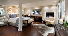 This is a basement reno by Candice Olson.  Love the rug on the floor!