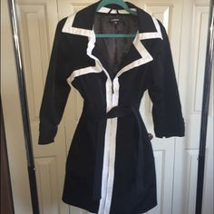 Bebe trench coat Bebe trench coat for sale. Black and white. Comes with belt. No good. Sleeves are 3/4.. Come down past elbow. Size large Bebe Jackets & Coats Trench Coats