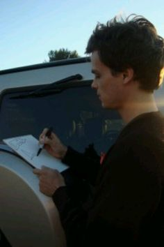 I love how he uses all his fingers to hold a pencil!