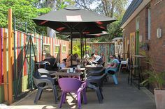 Open Book Cafe is a funky bohemian oasis that is cafe by day and morphs into a pizzeria by night, tucked along the side of a local Everton Hills shopping centre. Book Cafe, Open Book, Everton, Cafe Restaurant, Places To Eat, Brisbane, Trips, Restaurants, Park