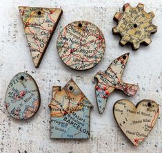 Little wood charms decoupaged with vintage maps - cute! try to find scrapbook paper with map and create ornaments of where we've visited - I love this idea! Map Crafts, Wood Crafts, Diy And Crafts, Arts And Crafts, Crafts With Maps, Map Projects, Projects To Try, Christmas Crafts, Christmas Decorations