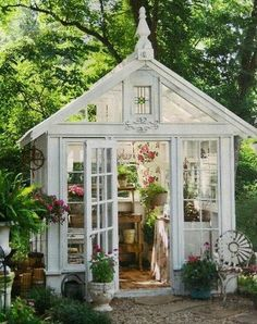 I really wish I had a garden big enough for a glass greenhouse like this in my current home !