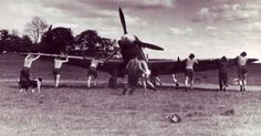 Norwegian ground crew pushes a Spitfire at Catterick, 1942 Air Force Aircraft, Ww2 Aircraft, Mk 1, Supermarine Spitfire, Ww2 Planes, Battle Of Britain, Royal Air Force, World War Ii, Airplanes