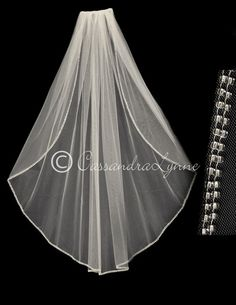 Two rows of silver lined seed beads embellish the edge of this fingertip wedding veil. it is 40 inches long and 72 inches wide, on a four inch metal comb.