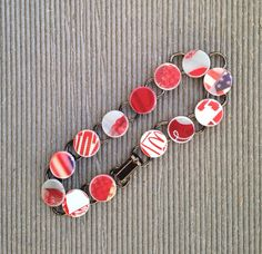 """Red and White bracelet made from Recycled Plastic Giftcard Bracelet, 8"""" Circle Charm Bracelet from McDonald's, Target, and Old Navy on Etsy, $10.00"""