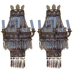 Pair of Cascade Form Gilt Bronze and Crystal Wall Light Sconces | From a unique collection of antique and modern wall lights and sconces at https://www.1stdibs.com/furniture/lighting/sconces-wall-lights/