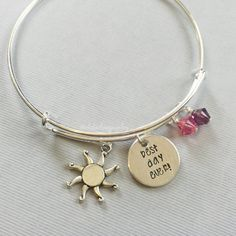 Rapunzel inspired bracelet featuring the words, best day ever. Its accented with a sun charm and Swarovski crystals.  Each item is made to order, and each letter is stamped individually by hand, every necklace will be slightly unique. The product you receive may vary from the photo shown. Charms and beads will remain the same.  Bangle is adjustable. Disc is aluminum with a brushed finish. It measures 5/8. If you need this item quickly please contact me for rush order information. (Leavin...