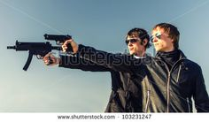 man holding two guns - Google Search