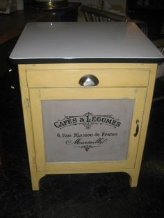 This vintage enamel top cabinet was painted with American Paint Company colors Amber Waves of Grain and Smoke Signal.  A graphic was added along with new hardware and voila'!