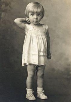 1940s studio portrait of pretty Eastern European immigrant girl.