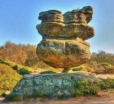 Idol Rock, Brimham Rocks-North Yorkshire, England. It weighs 200 tons and balances on a rock a fraction of its size.