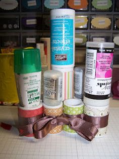 Stickles, glue, and etc. holder. Made out of PVC pipe and patterned paper. Good idea!