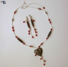 Ethnic Tibetan necklace and earrings with a heart yak bones and dark red crystal drop by TaliBellule