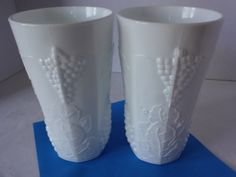 Vintage Pair of Colony Harvest Milk Glass Tumblers.  Pair of pure white milk glass tumblers in detailed Colony Harvest Pattern featuring grapes, leaves, and vines. Display or use these sturdy tumblers