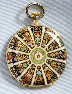 Detailed art adorns this pocket watch
