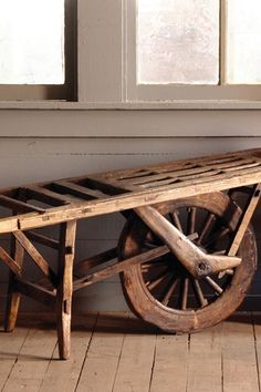 Rustic Antique Wheelbarrow Cart With Spoked Wooden Wheel And Slatted Top