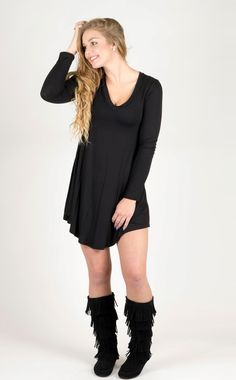 """This non-sheer knit jersey style t-shirt dress is unbelievably figure flattering and a perfect base piece to add to your closet. There are so many ways to change the look of this dress by adding a kimono, cardigan, vest, jewelry, boots or heels.        Material: 95% Rayon, 5% Spandex  Color: Black  V-Neck, long sleeve  Non-sheer, lightweight  Stretchy  Runs true to size  Length: Small-34"""", Medium- 34.5"""", Large-35.5""""  Sizing: Small (2/4), Medium (6/8), Large (10/12)    Model: Miranda is a…"""