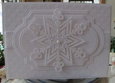 white card ... layers and layers and layers of white ... labels dies, ribbon, nested stars, snowflack, adorable dot clusters from embossing folder ... delightful ...