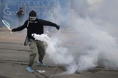 A protester uses a tennis racket to return a tear gas canister during a demonstration to protest the government's proposed labor law reforms in Nantes, France, on June 2. ( real shot)