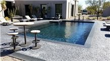 Blue Stone Coping and Black Pebble Tile Swimming Pool Pavement