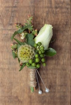 July boutonniere featuring scabiosa pod and lisianthus bud.  Designed by Love 'n Fresh Flowers.
