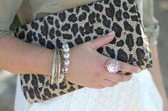I adore this leopard clutch. I have one but it is not as streamline as this one.