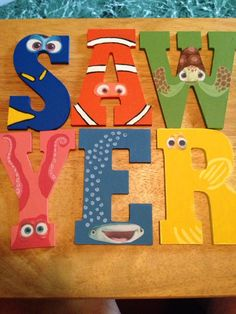 My grandsons birthday is Dory/Nemo theme and my daughter asked me to make the letters of his name (Sawyer) into the characters from the movies.  The letters are wooden and came from Hobby Lobby, then i printed the characters eyes from the internet and painted the rest to make it look like them.
